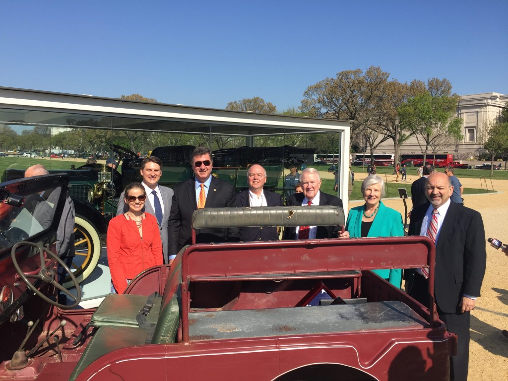 Members of the Reagan Ranch Board of Governors pose behind President Reagan's work-worn Jeep on the National Mall.