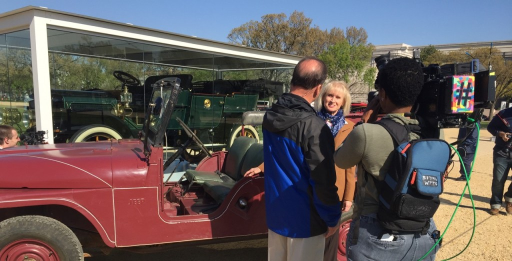 Reagan Ranch Curator Marilyn Fisher talks with WTTG News at the D.C. rollout of President Reagan's 1962 red Willys Jeep.