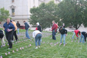 Students use string to create parallel rows of flags, maximizing the visual impact of their display.